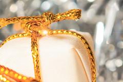 ... festive ... (wolli s) Tags: hmm holidaybokeh macromondays parcel bokeh gold golden macro makro