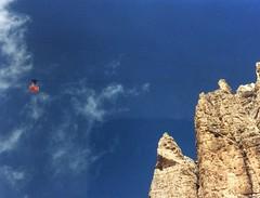 to the top! (Sylvia Okkerse) Tags: cablecar bluesky sunny blue red mountains peak italy trentino dolomites flickrtravelaward campitellodifassa dolomita worldheritagelandscape