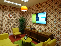 office hipster geeky tech trendy fun london whitechapel unruly smalls start up startup media company agency funny themed 70s meeting rooom orange vintage