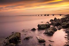 Zeelandbrug (Peter Gol) Tags: longexposure bridge sunset sea sky sunlight water clouds nd zierikzee vrouwenpolder sunglow ndfilter oosterschelde 1585 nd110 schouwenduivenland canoneos60d efs1585 noordbeverland