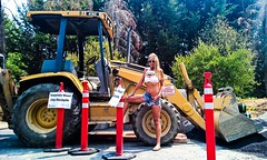 Bad Fonts: Nature's Aphrodisiac (lost.mohican) Tags: blue orange woman white signs sexy sunglasses yellow tank legs muscular top bra down belly blonde strong shorts pylons pulling abs printed unbuttoned fit earthmover slender raised cutoff