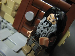 LoM UC: 5 (Micah the Fire-Breathing Hobbit) Tags: city roof horse statue wall soldier army riot hand lego stonework crowd medieval tudor cobblestone story fantasy hood cloak tale lom warg grueling