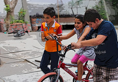 bike lessons (rjoseluis12015) Tags: people playing colors bicycle canon children bicicleta niños learning juego