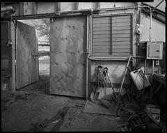 Greenhouse Interior, Door, Shovels, 2015 (wegee) Tags: door blackandwhite film interior wideangle 8x10 greenhouse fp4 shovels 2015 foodproject pyrocathd