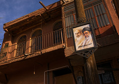 khameini and khomeini poster in front of an ancient building in zoroastrian village, Isfahan Province, Abyaneh, Iran (Eric Lafforgue) Tags: street old travel red portrait house building history tourism home sign horizontal architecture poster outdoors ancient day village iran propaganda traditional bricks middleeast culture persia nobody nopeople historic clay adobe destination historical leader kashan abyaneh attraction mudbrick ayatollah zoroastrian urbanscene persiangulfstates khomeini   natanz lowangleview 16501 colourimage  iro isfahanprovince redvillage  westernasia  natanzcounty