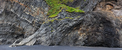 Columnar basalt at Reynisfjara in Iceland (Dmitri Naumov) Tags: panorama cliff beach nature horizontal landscape outdoors photography blacksand lava iceland sand nopeople rockface vik coastal shore backgrounds rough geology fracture volcanic touristattraction textured basalt locations tuff volcanicrock icelandic rockformation naturalphenomenon northerneurope 2015 blacksandbeach reynisfjara northatlanticocean traveldestinations colorimage famousplace naturalpattern columnarbasalt locallandmark rockpillar basaltcolumns atlanticislands naturallandmark beautyinnature landfeature reynisfjall nationallandmark stackrock nonurbanscene pillowlava southcentraliceland rockobject