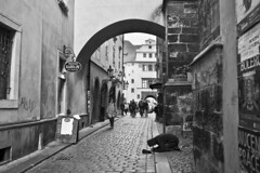 Somewhere in Prague (Tatiana Malevich (neverbluda)) Tags: street streetphoto streetphotography people bnw bw prague praha czechrepublic homeless begging architecture