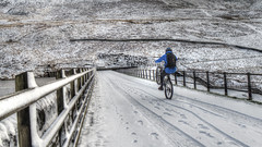 Preparing for a Fall? (Jay-Aitch) Tags: dovestonesreservoir saddleworth snow frost cold winter cyclist bicycle cycle slip fall wheelie bike lumix g vario 14140f3556 panasonic gx8 oldham
