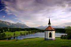 Small Chapel (parkerbernd) Tags: small chapel church schloss neuschwanstein castle green meadows summer evening mountains peaks alps allgäu alpen hegratsrieder see lake cross crucifix hilly landscape scenery trees clouds bayern country idyll germany