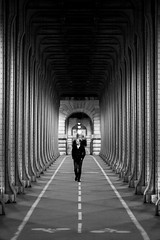 Bir Hakeim Bridge Stranger (Raphaël Melloul) Tags: bir hakeim paris bridge france parigi love black white stranger walk road chromatic raphael melloul photographer photographies photos photographe photography photo picoftheday photograph picture photographie bestoftheday beautiful symetric symetrie symmetric sigma 200mm f28 perspectiv building