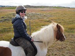Anette riding the Icelandic horse near Varhamlio