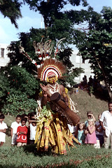 28-143 (ndpa / s. lundeen, archivist) Tags: girls man color film boys face festival fiji kids 35mm children necklace costume clothing audience drum traditional nick feathers culture makeup suva tourists southpacific drummer warrior 28 tradition 1970s facepaint spectators performer 1972 necklaces headdress onlookers dewolf oceania fijian pacificartsfestival pacificislands festivalofpacificarts southpacificislands nickdewolf photographbynickdewolf festpac pacificislandculture southpacificfestival reel28 southpacificartsfestival southpacificfestivalofarts fiji72