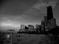 B&W Sunset (CTfoto2013) Tags: sunset lake chicago beach water monochrome night buildings lumix eau waves cityscape waterfront outdoor dusk lac lakemichigan panasonic shore lakeshore cote vagues nuit plage hancocktower immeubles gx7