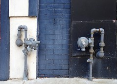 Black & Blue - Meters (Jae at Wits End) Tags: old blue white abstract building brick geometric lines architecture america catchycolors outside industrial pattern exterior graphic outdoor decay kentucky curves plumbing pipe shapes pale line diagonal southern faded american valve worn faucet weathered curve shape fixture paducah piping bluewhite bleached brickwork faint washedout discolored project365 blueandblack