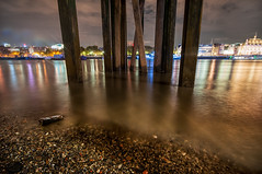 Under the Pier (Colin_Evans) Tags: city light england urban london english tourism beach water thames skyline architecture night buildings river landscape lights evening pier town cityscape riverside britain dusk jetty tide capital scenic illuminated flowing riverbank embankment thamesriver