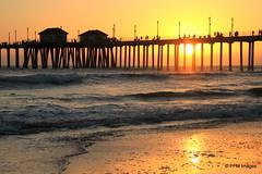 Huntington Beach Pier (pandt) Tags: ocean california sunset sea sky orange sun beach wet water clouds canon golden coast pier seaside sand flickr waves pacific outdoor sandy explore stunning serene huntingtonbeach explored
