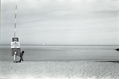 Kid at the Beach (m.ashe7) Tags: park bw film beach nature monochrome seaside kodak outdoor trix maryland coastal sandypointstatepark