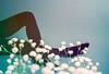 Sleeping Limbs (Hayden_Williams) Tags: girl woman legs stockings leggings feet pose model pretty beautiful flowers flower nature gypsophila multipleexposure tripleexposure doubleexposure analog analogue canonae1 fd50mmf18 kodakportra400 film dreamy