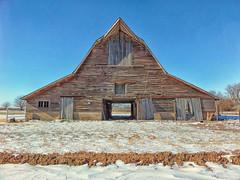 This one has a drive thru! (slammerking) Tags: kansas barn bluesky snow weatherd