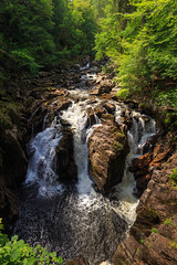 Black Linn falls. (Noel Wyn Davies) Tags: waterfall river riverbraan dunkeld perthshire scotland uk rocks trees summer sunshine leaves green foam water flow flowing