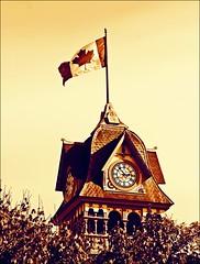 Sliders Sunday - Petrolia Ontario (Daryll90ca) Tags: petrolia petroliaontario ontariocanada ontario canada slidersunday flag canadianflag victoriaplayhouse victoriaplayhousepetrolia clock clocktower sliderssunday steeple