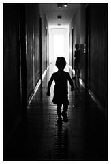 corridor (Milan Nykodym) Tags: blackandwhite child baby corridor backlight contrast simple run silhouete