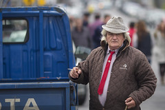 The man and the blue Toyota (Frank Fullard) Tags: street blue ireland red portrait horse irish galway hat cigarette candid toyota smoker ballinasloe horsefair fullard frankfullard
