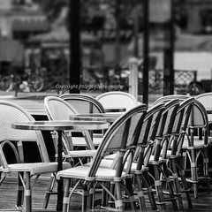 Typical cafe in Paris (jmlpyt) Tags: france table outdoors restaurant town cafe chair pattern furniture empty seat lifestyle nopeople patio sidewalk curve cafeteria wicker parisfrance urbanscene tiltshiftlens bardrinkestablishment