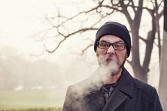 Blowing Smoke (Danielle Denham-Skinner) Tags: portrait people man cold male canon cigarette candid smoke gray stjohns smoking portlandoregon stockingcap peacoat foggymorning cathedralpark canon70200l canon6d