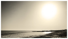 Straight into the sun (rhfo2o - rick hathaway photography) Tags: sunset sea blackandwhite bw sun mist beach seaside waves westsussex horizon groyne sanddunes seamist littlehampton iphone rustington iphone4s rhfo2o