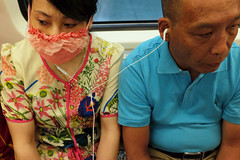 2655 miles since (lille abe) Tags: china street woman man subway fuji dress mask metro tube belly chengdu michal earphones pachniewski