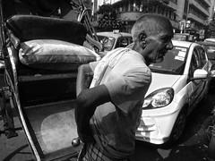 Age no bar (Rajib Singha) Tags: street travel portrait people india work interestingness transport age kolkata westbengal handpulledrickshaw flickriver canonpowershots90