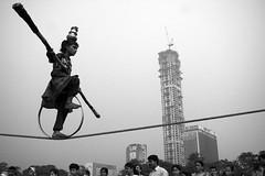Life on a tight rope balance(Explored} (Rajib Singha) Tags: travel street outdoor girlchild jugglery profession balance struggle interestingness flickriver canoneos40d kolkata westbengal india