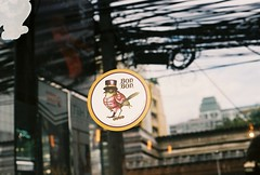Bon Bon (35mm) (jcbkk1956) Tags: bangkok thailand window reflection sign minolta xd7 manualfocus 50mmf17 analog street fujicolour200 35mm thonglo bar worldtrekker cables wiring dof