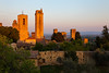 Golden Towers - Italy, San Gimignano (Nomadic Vision Photography) Tags: sunset italy towers medieval unescoworldheritagesite tuscany sangimignano towerhouse goldenlight jonreid tinareid nomadicvisioncom