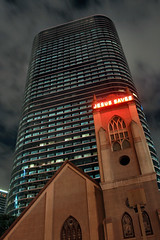 God and Mammon (bill barfield) Tags: building church architecture night downtown texas houston jesussaves chevron enron