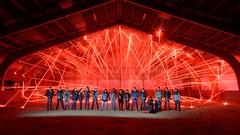 Spreading the light (palateth) Tags: red portrait lightpainting night training belgium belgique belgie fireworks group urbanexploration ig urbex lightart katyusha lightpainting101