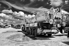 Industrial Strength - Trinity,Texas (Rob Sneed) Tags: usa texas trinity industrial crane 800tondemag deepsouthcraneandrigging sign cable mobile smalltown mudpuddle easttexas deepsouth advertising bw oversizeload americana clouds