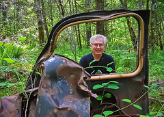 """""""I've been framed."""" (axiepics) Tags: wood trees portrait people canada cars abandoned car metal trash forest portraits moss woods junk rust automobile iron bc faces britishcolumbia machine vancouverisland machinery human f frame utata autos machines wreck scrap oldcars automobiles carwreck wrecks underbrush abandonedcars blackandgreen ©copyrightalexskellyallrightsreserved"""