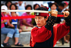 Suwon Martial Arts Performance Suwon South Korea Ssang soo do style or long sword style. (Derekwin) Tags: training asian dangerous asia martial cut attack performance arts korea sharp derek korean weapon sword strike blade southkorea winchester hwaseong suwon skill katanna hwaseonghaegung derekwin derekwinchester  kimjoonyoung
