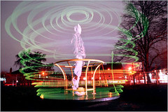 Merry Glo Round (Danny Fontaine) Tags: park longexposure nightphotography light abstract art night dark stars skeleton religious skull lights weird moving scary abstractart roundabout surreal spooky lasers mysterious laser nightshots nightsky merrygoround ai nightphotos nightpics nightphotographs unworldly antidoteandinfamy dannyfontaine religiousphotography