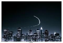 Superman on his way (Arnold Pouteau's) Tags: nyc newyorkcity newyork skyline night chopper downtown manhattan f50 spot1