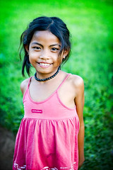 red on green - red girl green cambodia smile dress phitar 2006