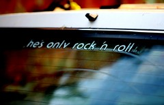 rock and roll (Lastexit) Tags: macro abandoned window car closeup sticker colorful dof maine depthoffield 5d bumpersticker rockandroll