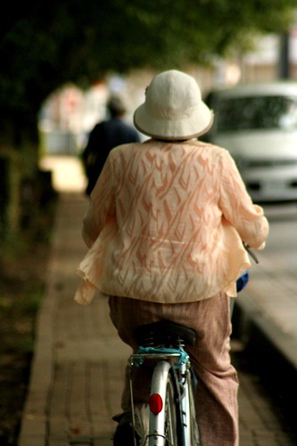 Old Lady Riding Bike