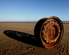 Wheel on Beach (Davoud D.) Tags: deleteme5 sunset deleteme8 deleteme deleteme2 deleteme3 deleteme4 deleteme6 deleteme9 deleteme7 beach wheel metal wales found junk rust saveme deleteme10 decay cymru round rubbish lonely waste sands pendine longshadows longshadow pendinesands