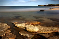 sea-through (Ray Byrne) Tags: longexposure sea beach water canon 350d coast still rocks crystal north calm clear northumberland shore transparent northeast ndfilter sugarsands lowstead raybyrne tenstopsofdarkness byrneout byrneoutcouk webnorthcouk