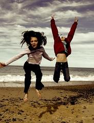 Yippee!! (Earlette) Tags: sky beach kids children fun high jumping sand bravo waves ashleigh colourcolor