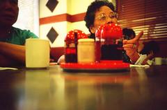 making her point (poopoorama) Tags: grandma red canada film cup restaurant lomo lca kodak britishcolumbia chinese maggie richmond soysauce e6 e100vs mckimwontonmeinsaga