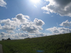 Bicycling in Waterland (albireo*) Tags: sky sun holland grass clouds uitdam